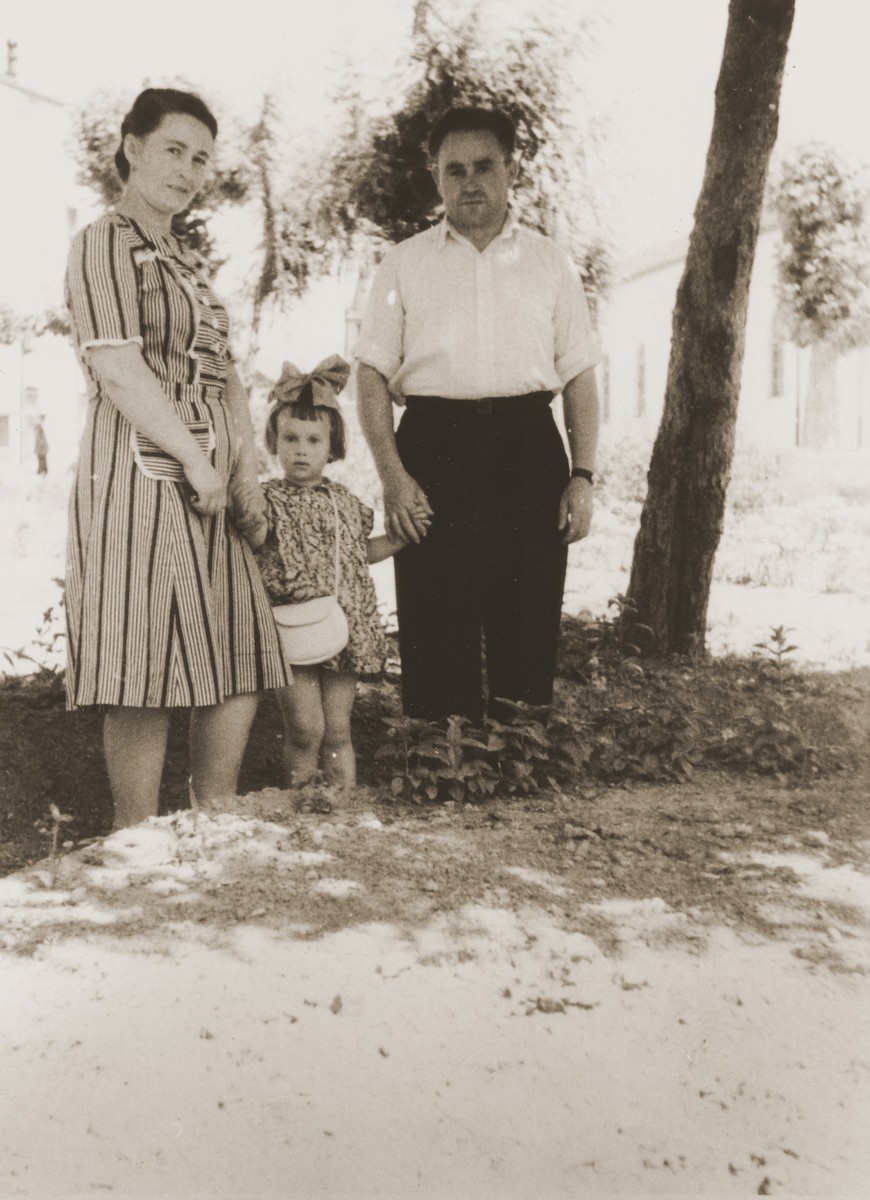 A Jewish DP family poses outside in the Cremona displaced persons camp.  Pictured are Motel, Zelda and Masha Leikach.