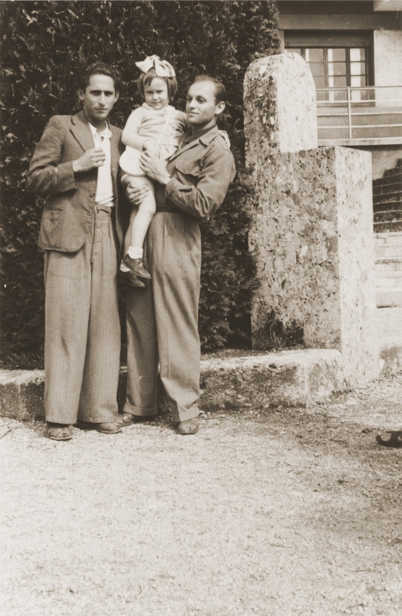 A Jewish DP child poses with two young men at the children's home in Selvino, Italy.  Pictured are Masha Leikach and her mother's cousin, Moishe Schwartzblatt.