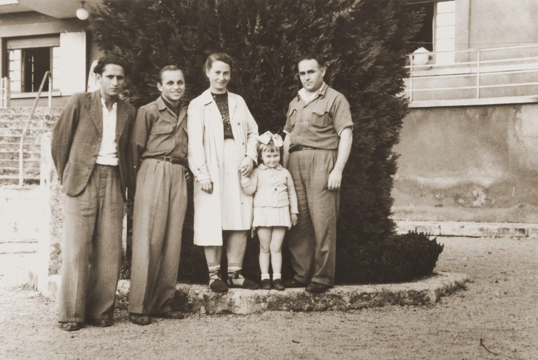 Group portrait of Jewish DPs at the children's home in Selvino, Italy.  Standing left to right are: Moishe Schwartzblatt, unknown, Zelda Leikach, Masha and Motel Leikach.
