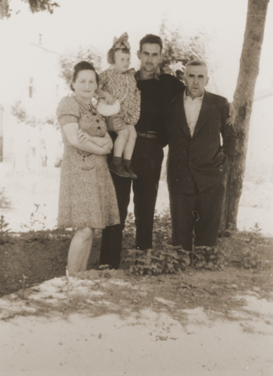 Group portrait of Jewish DPs in the Cremona displaced persons camp.  Pictured are Masha Leikach (second from the left), her neighbors, Chaika and Chaim Katz (far left and far right), and their nephew Moishe Katz.