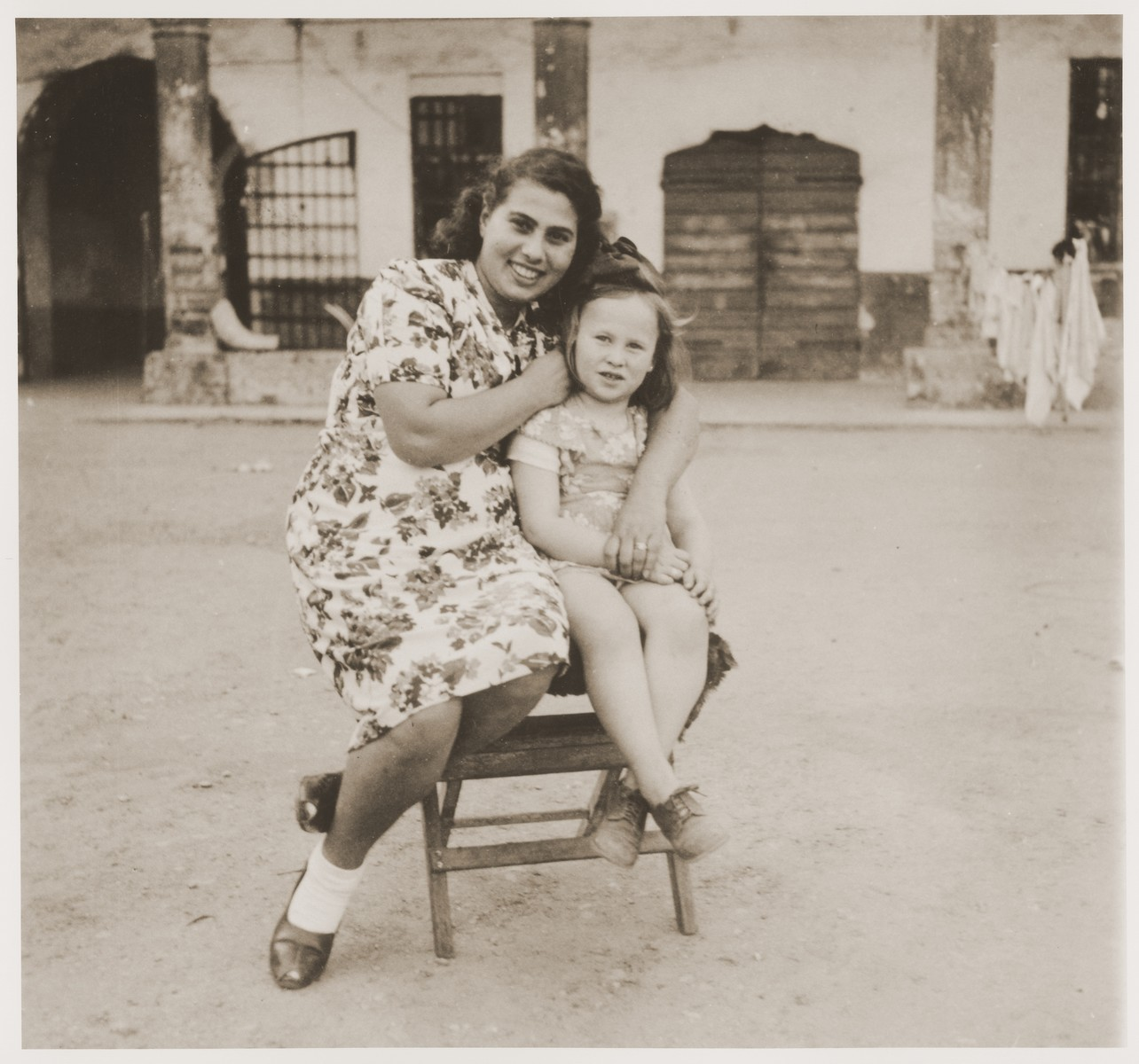 A Jewish DP child poses with a young woman in the Cremona DP camp.  Pictured is Masha Leikach and a woman named Hinda.
