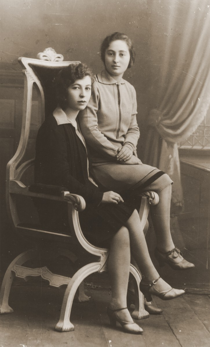 Studio portrait of two Jewish sisters in Goloby, Poland.  Pictured are Tzina and Eta Leikach, the sisters of Zelda Leikach.  Both perished during the war.