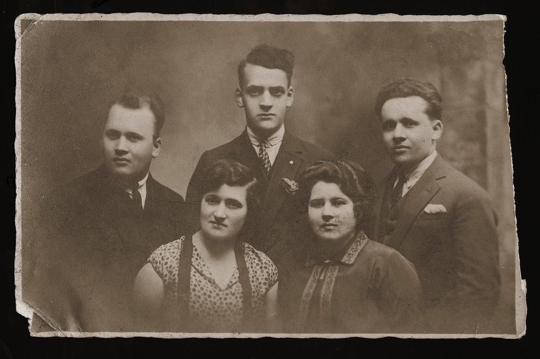 A group portrait of Polish Jews from Dabrowa, given to the donor's brother, Rubin Rozen, as a memento of his passing through Brussels on his way to the United States.