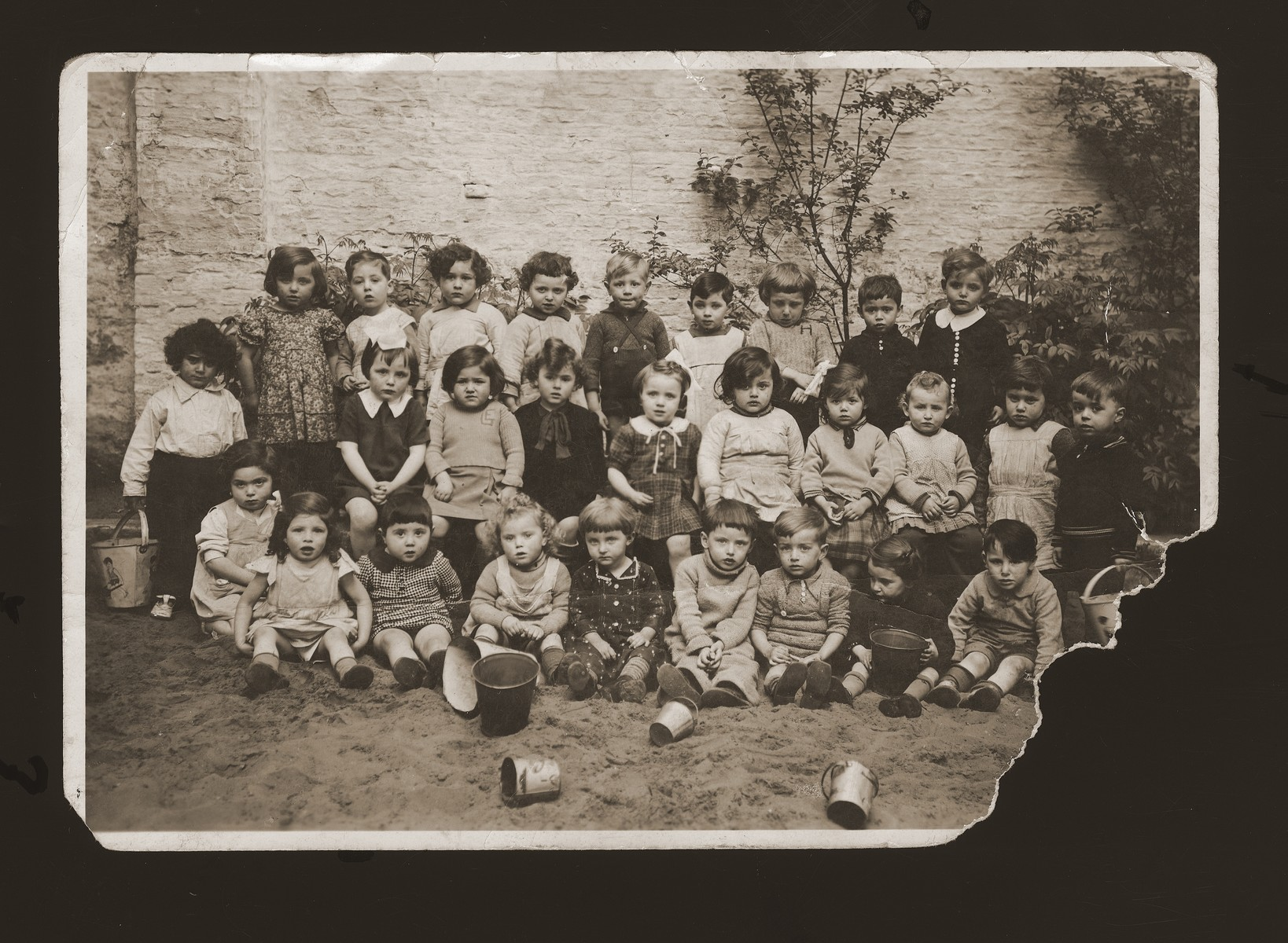 Group portrait of a nursery school class in Antwerp.    Among those pictured is Lucie Zalc (middle row, fourth from the right).