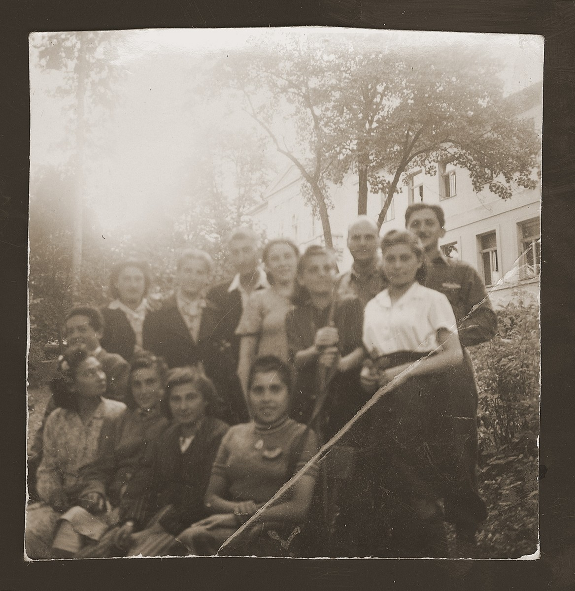 Group portrait of young Jewish women, survivors of the death march to Volary.    Among those pictured is Moniek Rozen (standing third from the left).