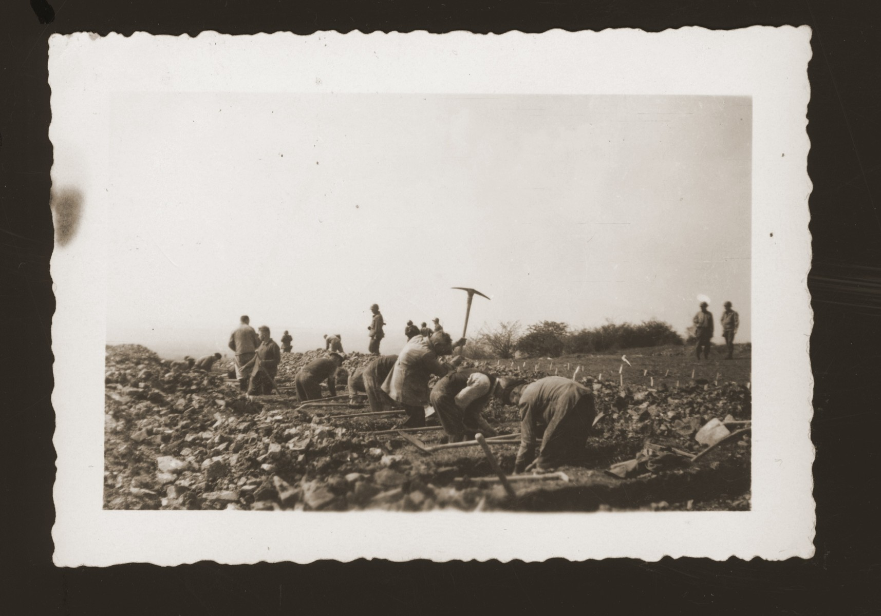 Germans are forced to prepare graves for the victims of Ohrdruf.