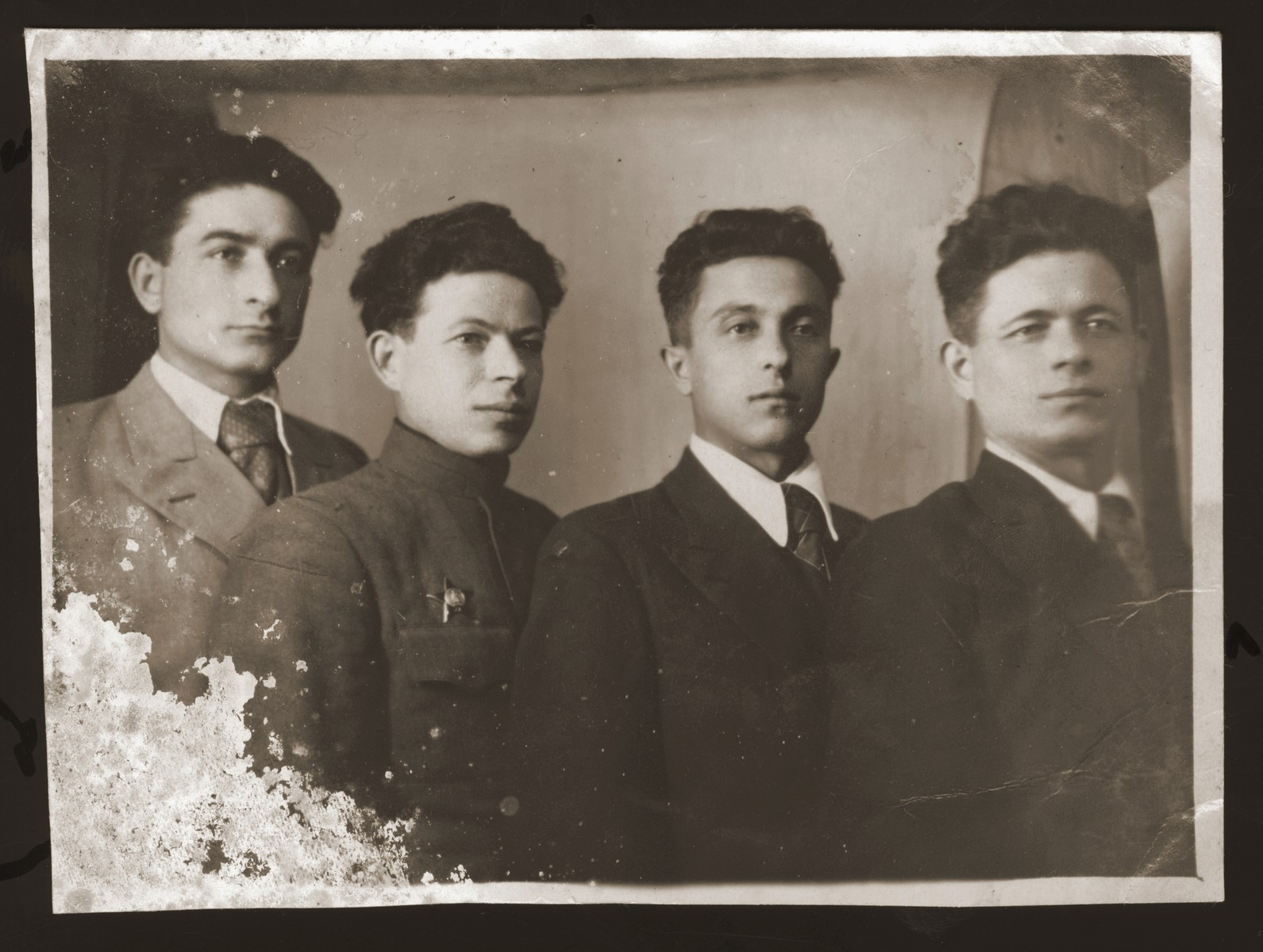 Group portrait of four young Jewish men in Gorky.  Pictured from left to right are the three Lewin brothers: Yuri, Abram and Misha.  At the right is their cousin, Jasha Kushnir.