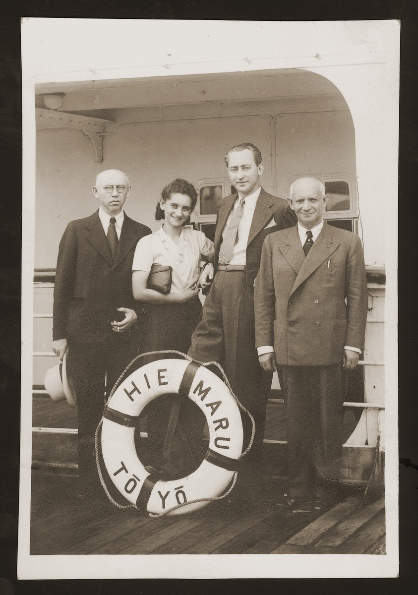Polish refugees pose on the deck of the Hie Maru prior to their departure for America.  From left to right are I. Lederman, Edwarda Wang, Wtadystow Runcewicz and Szymon Wang.