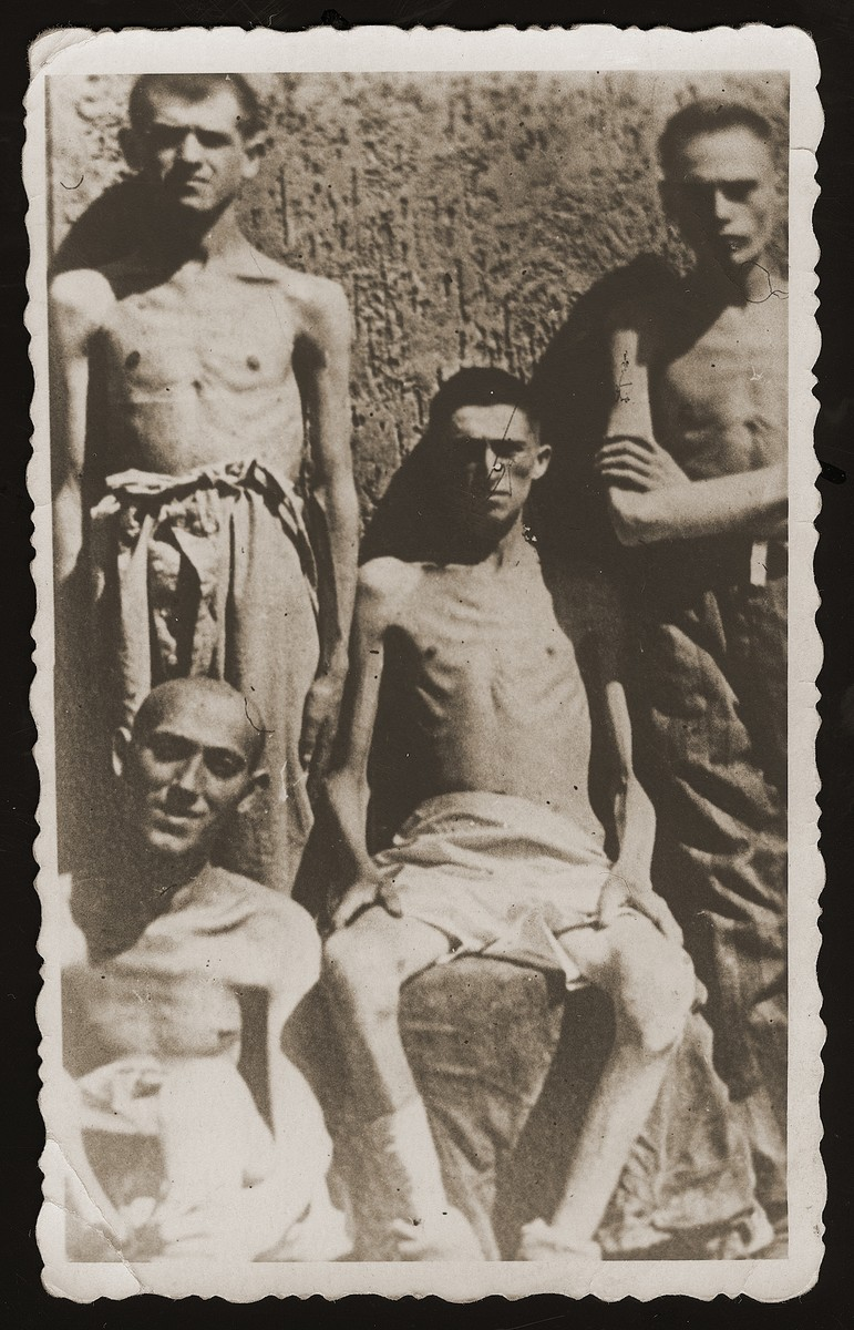 Group portrait of four Jewish youth at liberation in Buchenwald.    Nucher, (the donor's friend) is pictured in the lower left.  Pictured in the center if Jacob Rosenthal from Satu-Mare.