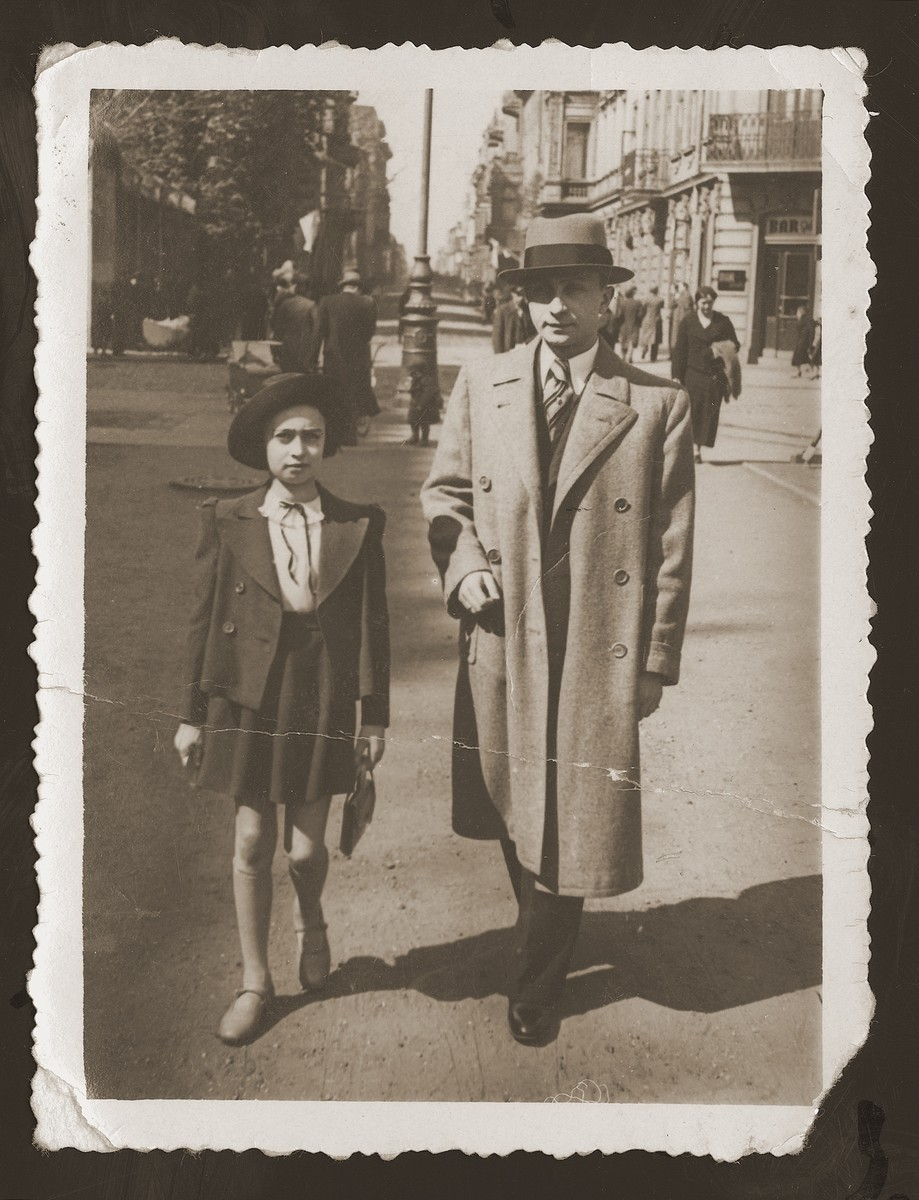 Mates Maks Bilauer, donor's future brother-in-law, walks in the street with his daughter.    Maks met and married Rozka Rozen, the donor's older sister, in the USSR.  Maks' family perished in the Lodz ghetto.
