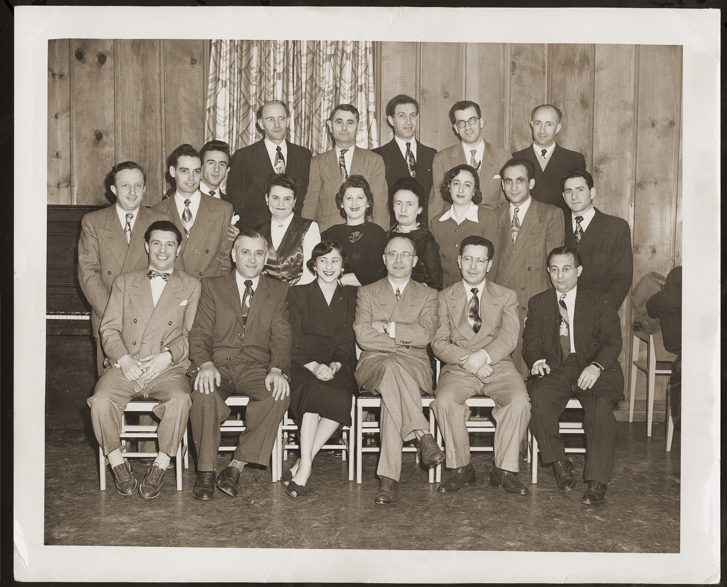 A group portrait of newly arrived Jewish immigrants and survivors.    Among those pictured is Josef Rozen, the donor's brother, in the second row, first from right, and Mr. Kaufman, an HIAS representative, seated in the first row, third from right.