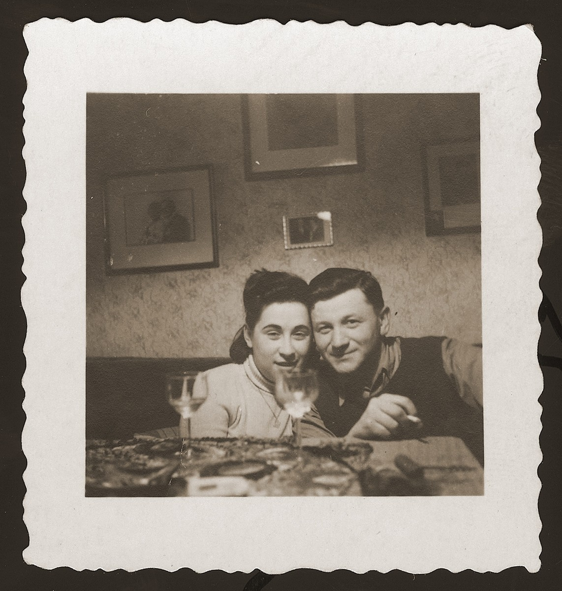 Two Jewish DP siblings, who have been recently reunited, pose in an apartment in the New Palestine displaced persons camp near Salzburg.  Pictured are Zygmunt and Genia Litwak from Dabrowa Gornicza, Poland.