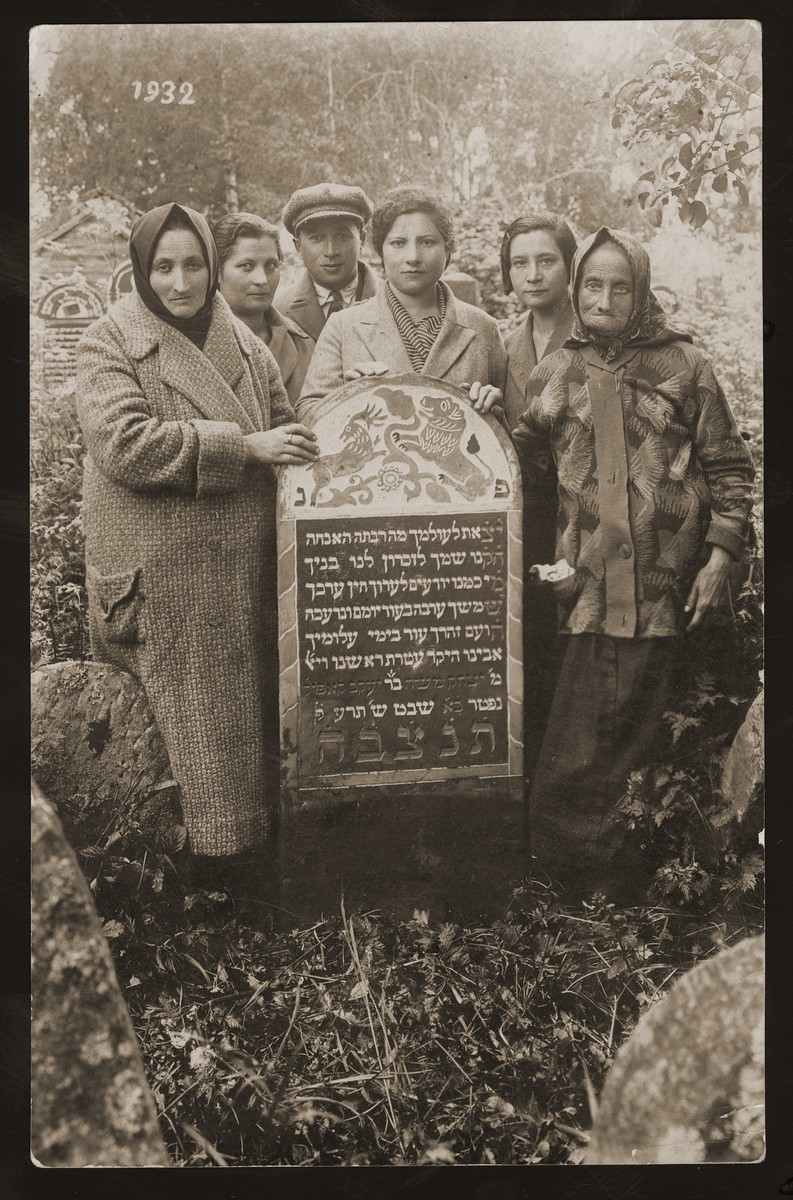 Family members gather around the tomb of Yitzhak Moshe, the son of Yaakov Kapol.