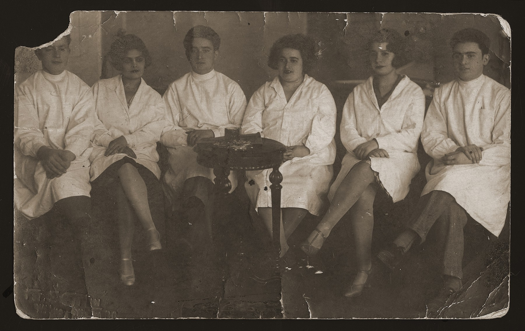 Group portrait of the employees of a beauty salon in Vilna.  Among those pictured is Anna Wajner.