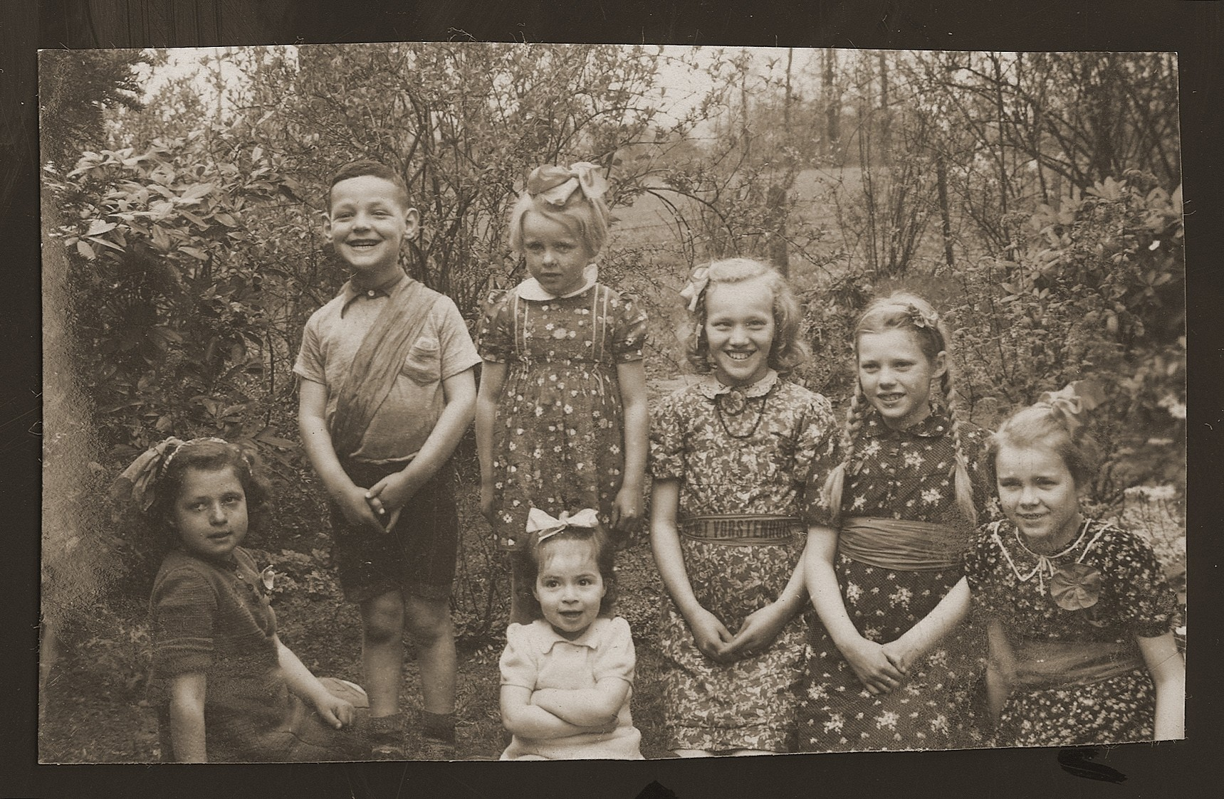 Jewish children who had been in hiding pose outside with Dutch children on liberation day.  Rachel Kats is in the center.