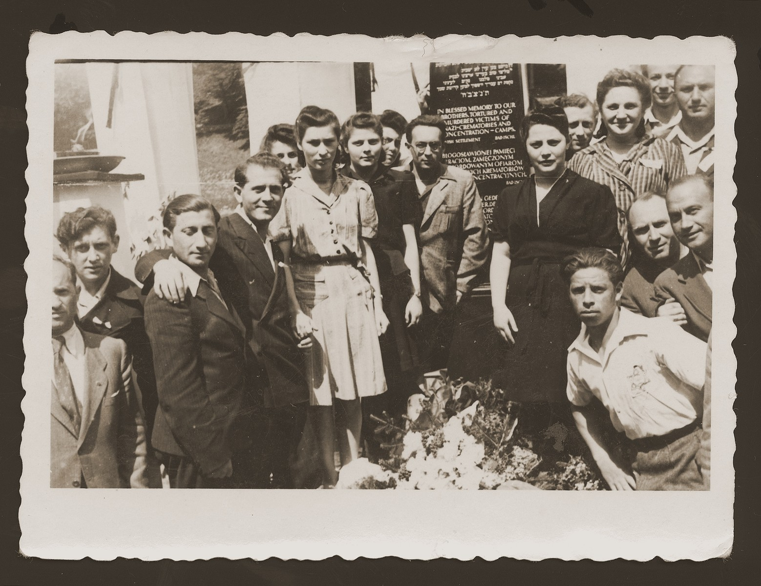 Jewish DPs from the New Palestine displaced persons camp gather around a memorial erected to the Jewish victims of the Nazis.   Among those pictured is Moniek Rozen (third from the left), Kazik Szancer (fourth from the left) and Rela Szancer (fifth from the left).