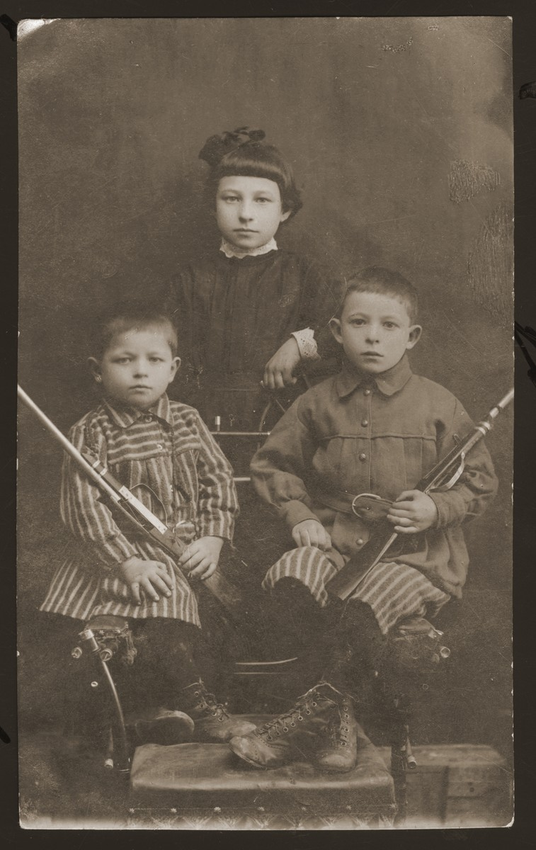 Studio portrait of the Lewin children in Derazhnya.  Pictured are Abram (left), Misza (right) and Becky (standing).