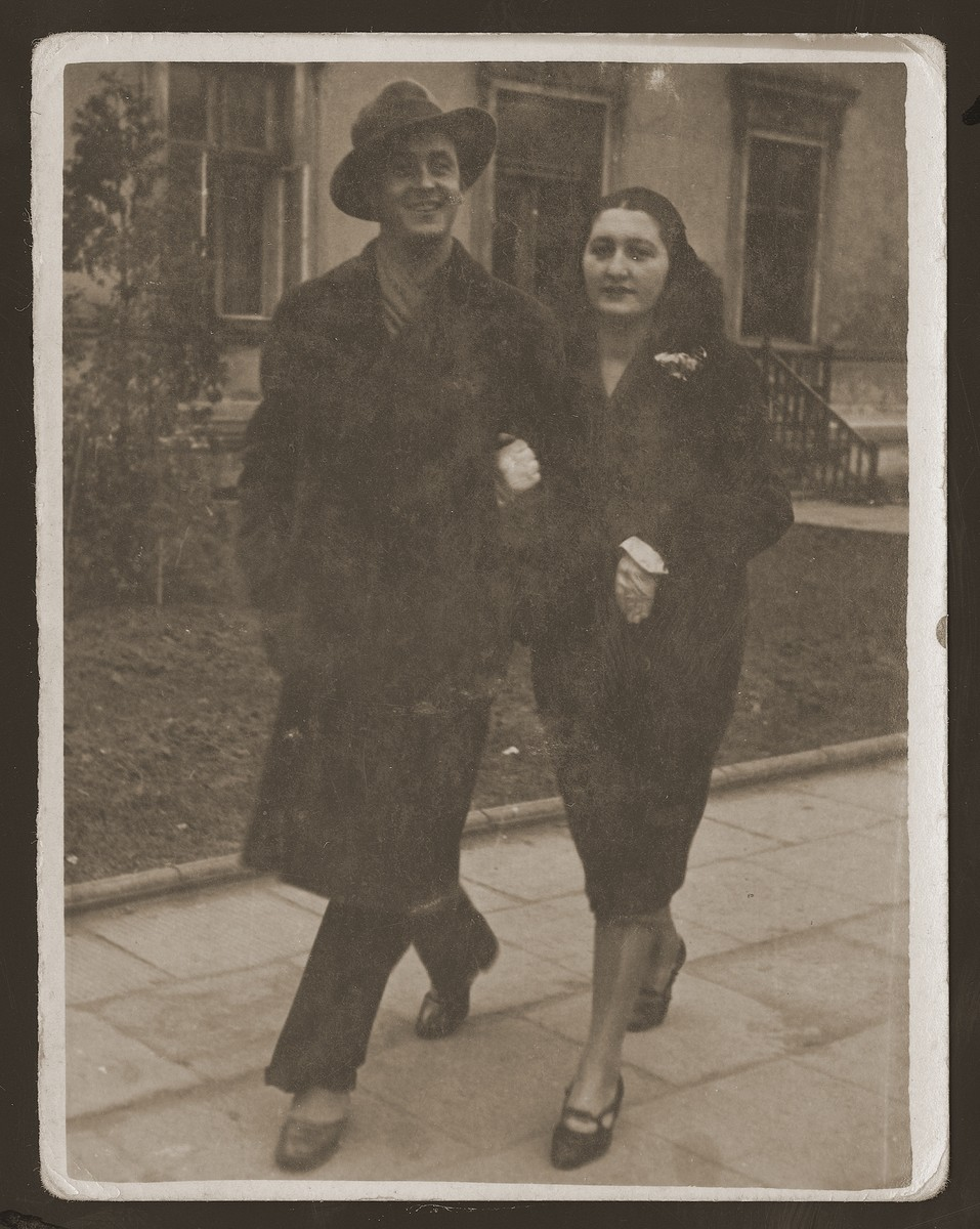 Rozia , the donor's older sister, walks in the street of Dabrowa with her husband, Moniek Szwimer.   Rozia and Moniek Szwimer fled Poland in 1939 to the USSR.