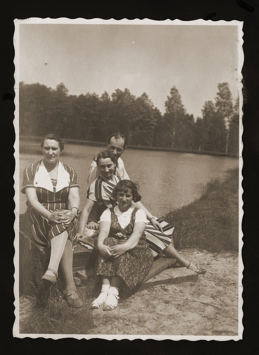 Emilia and Edwarda Wang and two family friends sit on the shores of a lake of their estate Poreby Kupienskie, near Kolbuszowa.