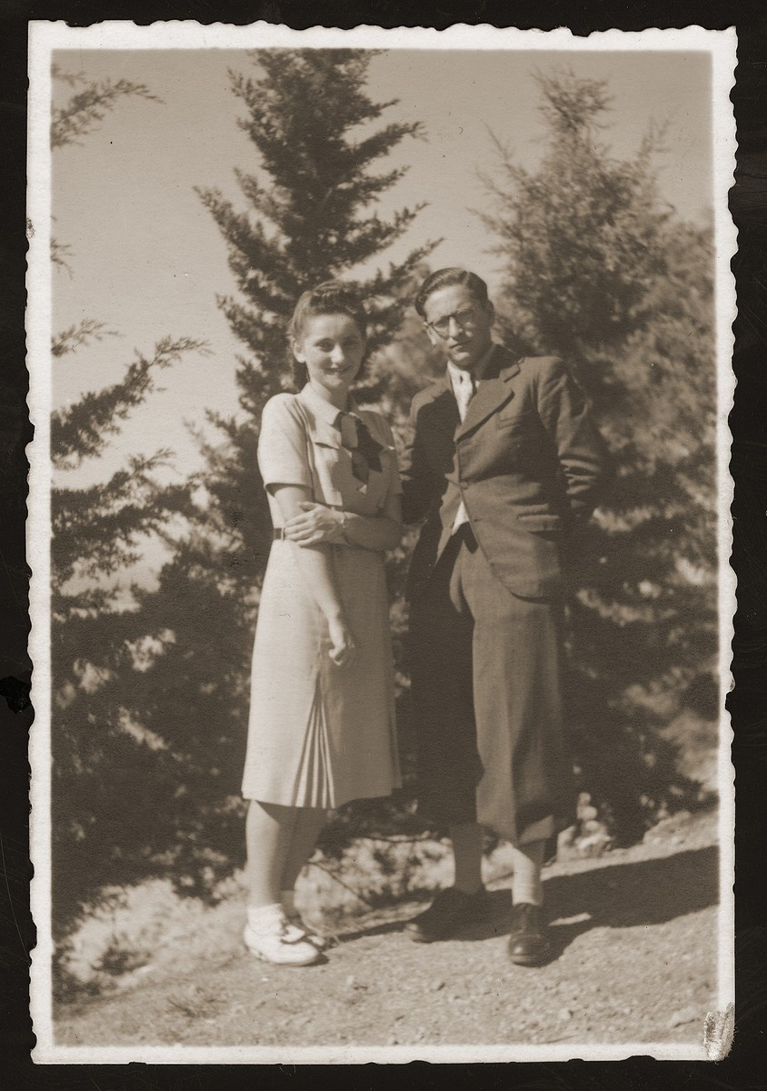 Jewish refugees, Edwarda Wang and Fritz Kohn, stand near a pine grove in Istanbul.