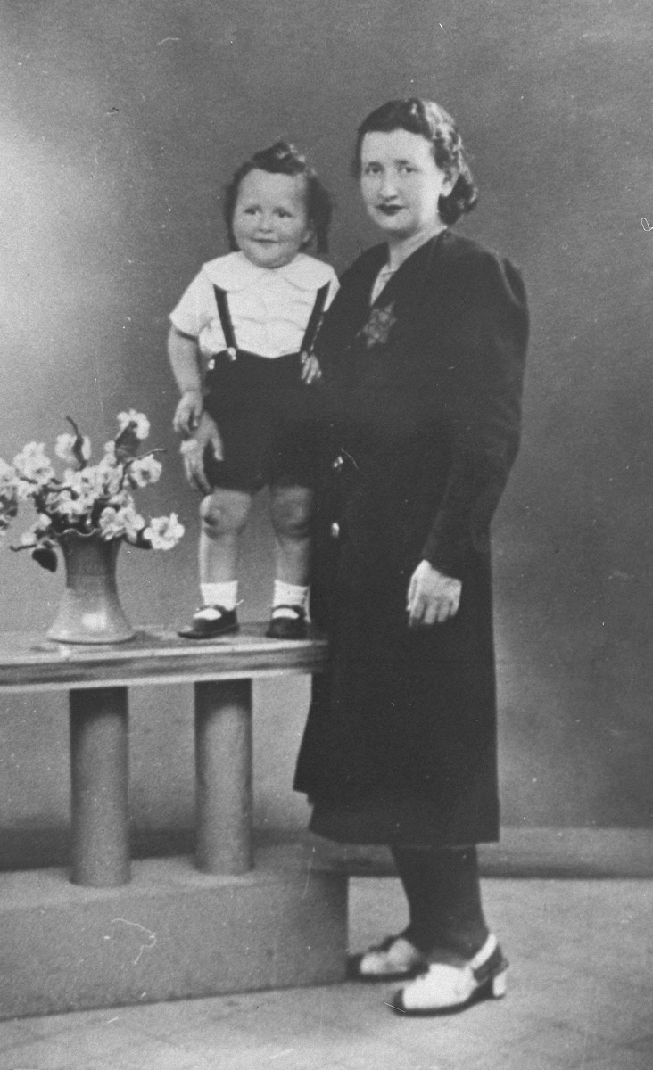 Esther Zvia Tashidler with her youngest son, Marcel.  Esther was arrested in 1942 while visiting her daughter, Rachel, at a Jewish children's home.  She was taken to Drancy and later died at an unknown location.  Marcel, who was with his mother at the time of her arrest, was hidden by a French woman who was the concierge of the building where he lived.  In 1948, Marcel, along with his brother Simon, was adopted by an Algerian Jewish family, the Djournos.