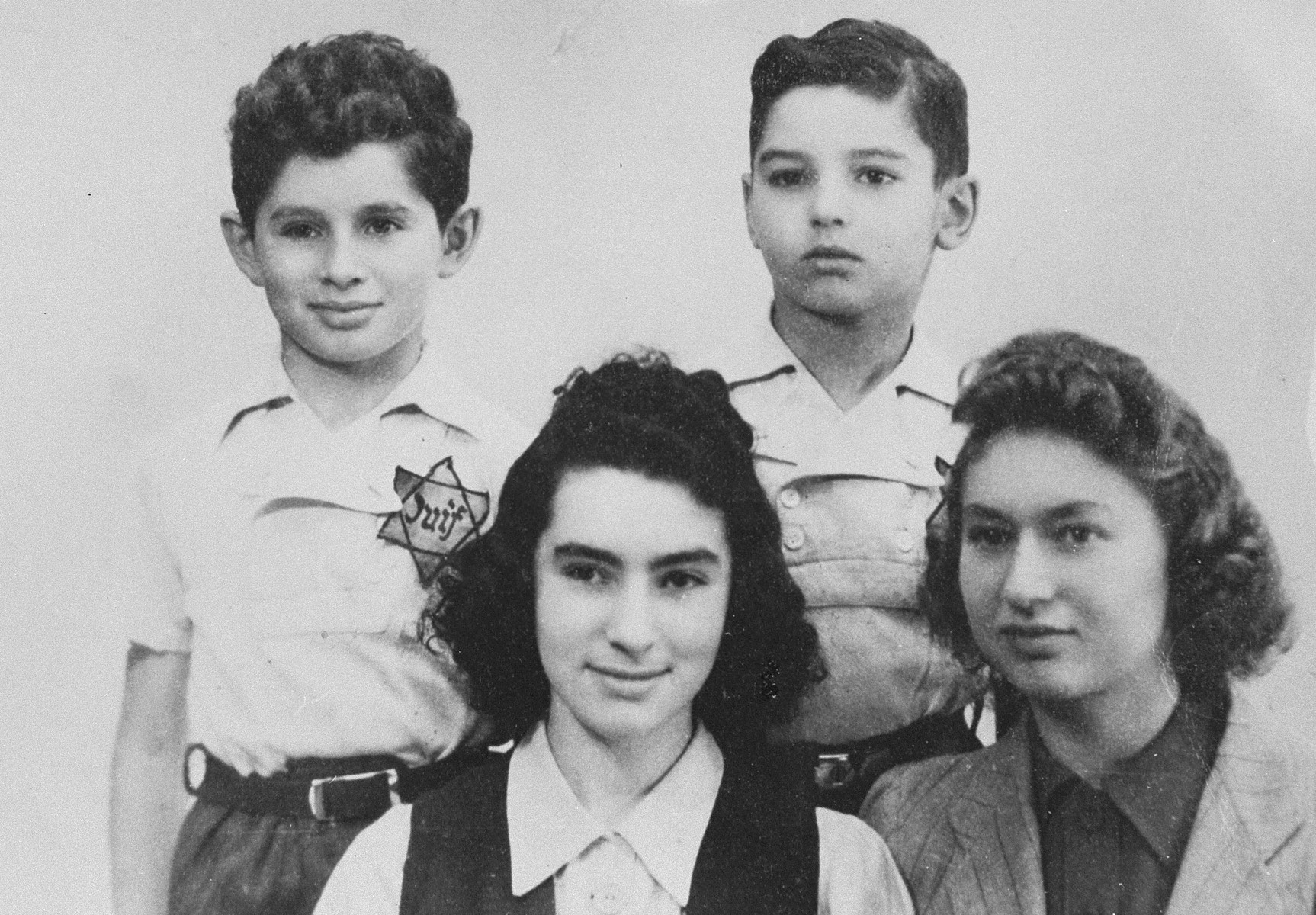 The Margules children wearing Jewish badges.  Originally from Warsaw, the Margules family settled in Paris in the 1930s.  Three of the children were deported and killed in 1942.  Only one daughter (pictured at the bottom right) survived the war.