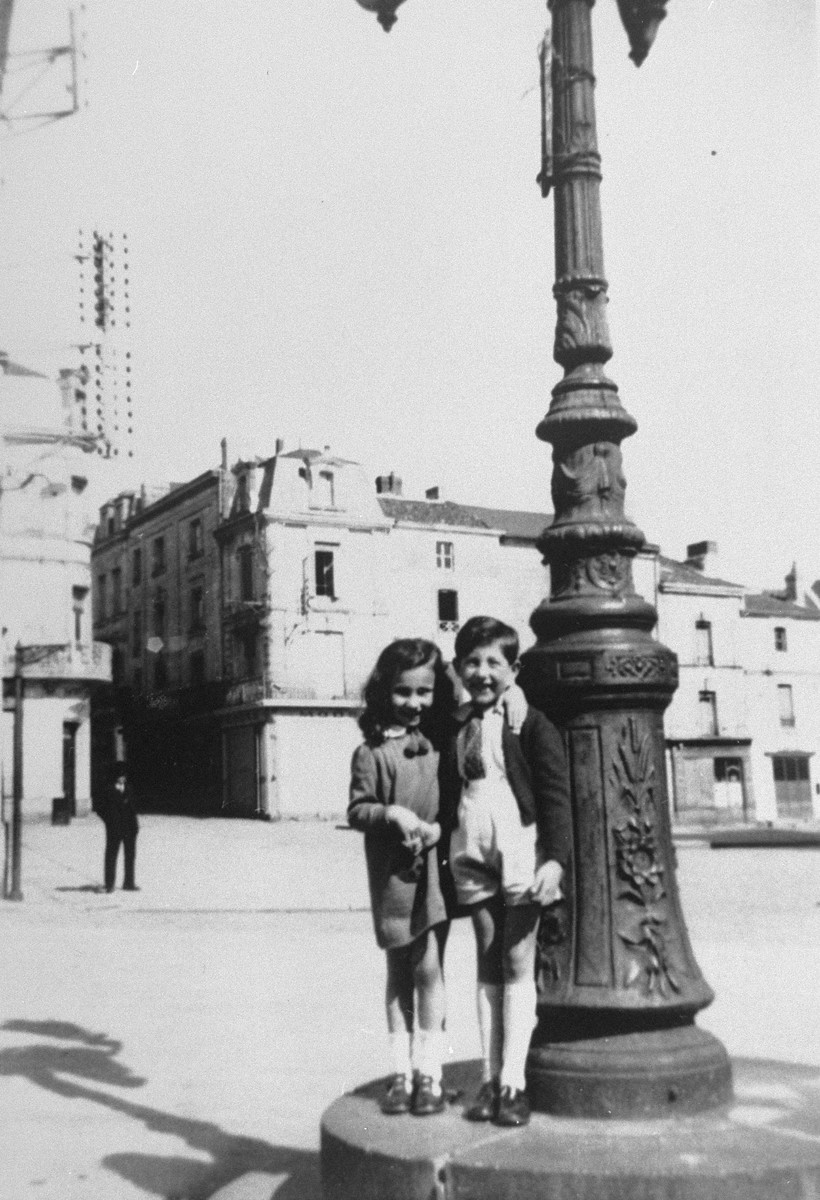 Two children stand next to a lamp-post in Loudun.   Pictured are Liane Reif and Jean-Paul Berg. Jean-Paul Berg, Liane's friend perished during the Holocaust.
