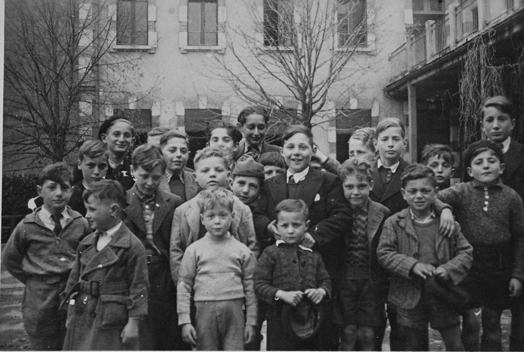 "Group portrait of Jewish children at the OSE home, ""Maison des Pupilles de la Nation,"" in Aspet, France.    Gunter Haussman is standing at the top left.  The children were brought to the home from French transit camps with the assistance of the American Friends Service Committee (AFSC) and the Oeuvre de secours aux enfants (OSE)."