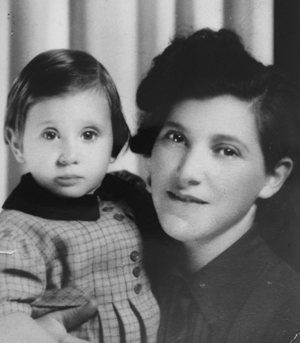 Portrait of a Jewish woman and her young daughter.  Pictured are Evi Weis with her mother, Magda Pollak Weisz, while en route out of Paris in 1941.