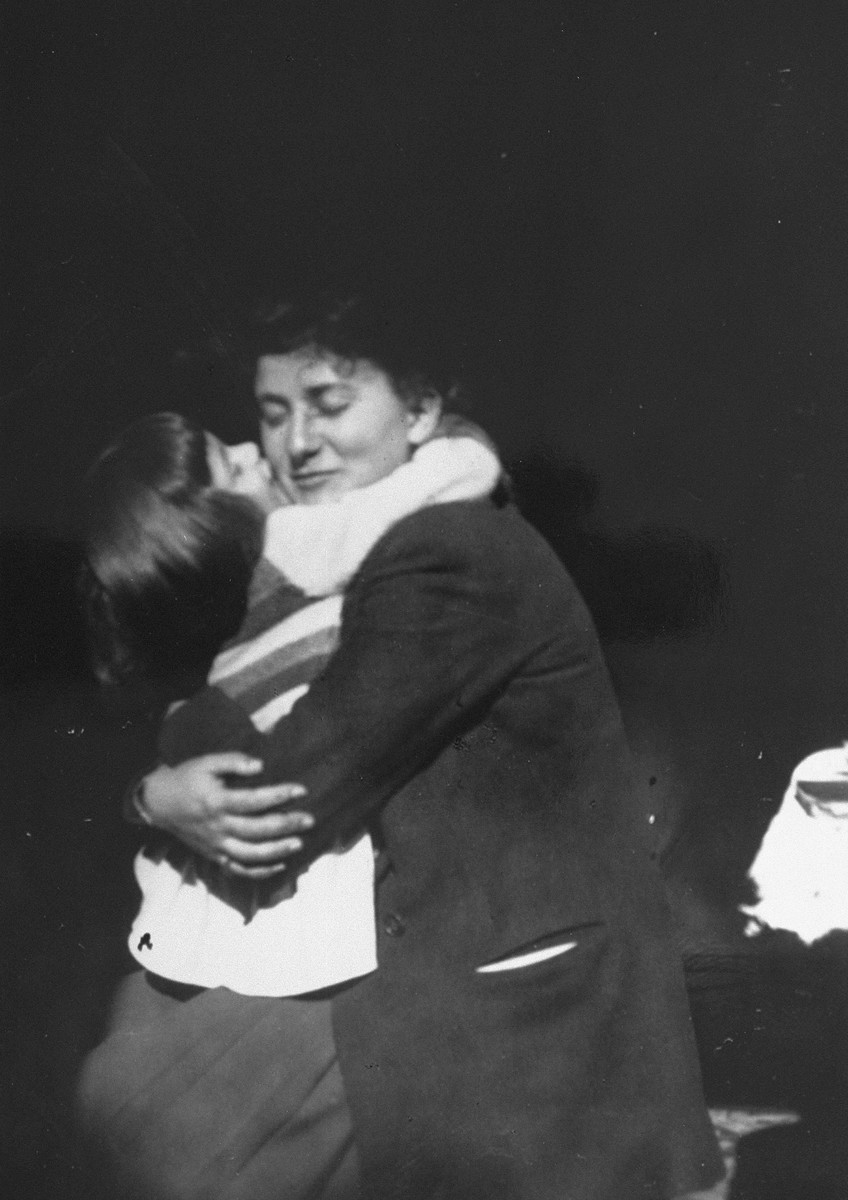 Renée Pallarès hugs Diane Popowski, a Jewish child from Luxembourg, whom Renée's family adopted after she was rescued from a nearby internment camp.