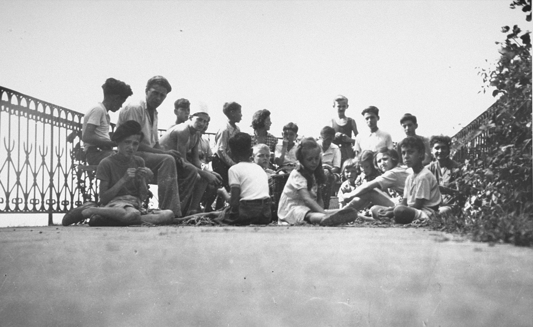 Jewish refugee children sit on the terrace of the children's home in Izieu.