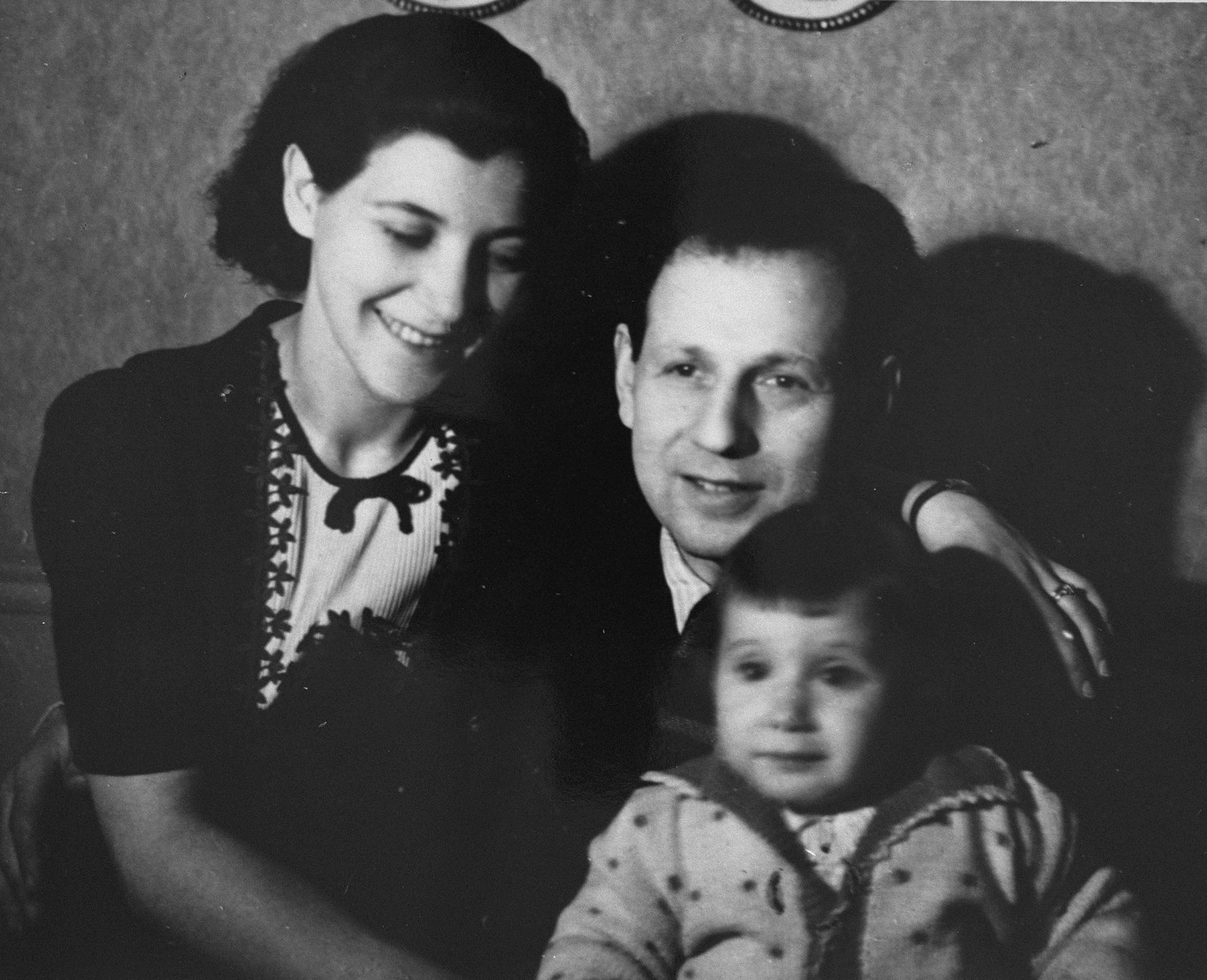 Portrait of a Jewish family in Paris around the time of the German invasion.  Evi Weisz with her parents, Hermann and Magda Pollak Weisz.