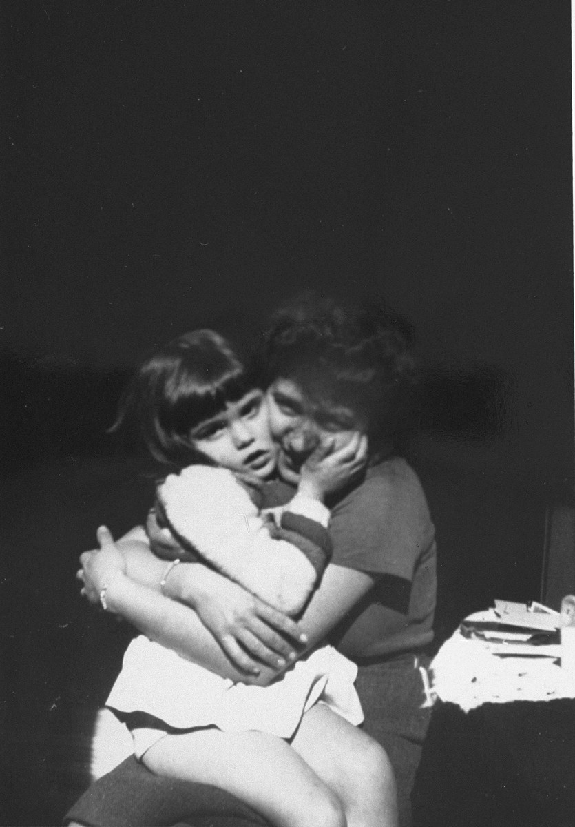 Paulette Pallarès hugs Diane Popowski, a Jewish child from Luxembourg, whom her family adopted after she was rescued from a nearby internment camp.
