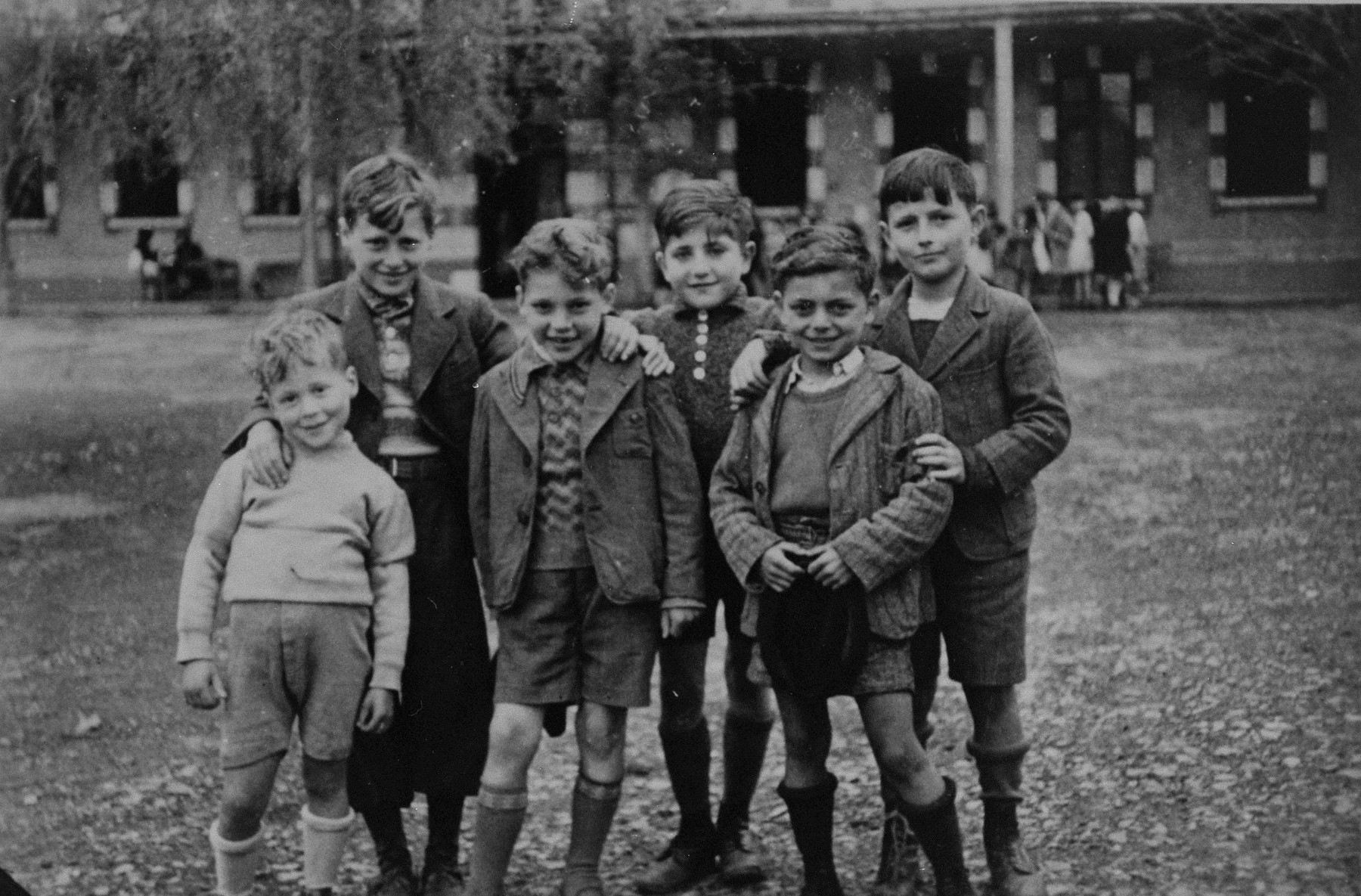 "Group portrait of six German-Jewish refugee boys living at the OSE children's home, ""Maison des Pupilles de la Nation,"" in Aspet, France.    Pictured from left to right are:  Ernst Weilheimer, Richard Weilheimer, Rolf Hess, Hugo Schiller, Hjalmar Maurer and Kurt Walker.  These boys were brought to Aspet from French transit camps with the assistance of the American Friends Service Committee (AFSC) and the Oeuvre de secours aux enfants (OSE).  The AFSC later secured their passage to the United States."