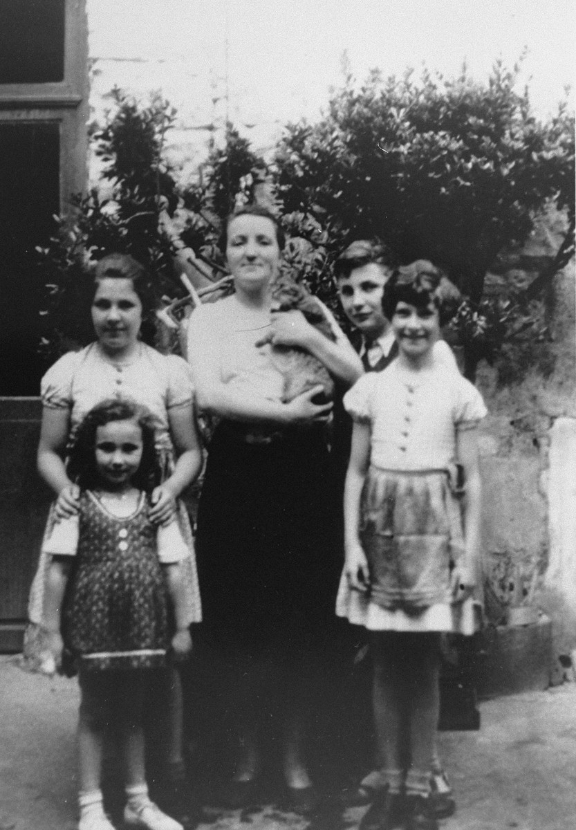 A group of children stand with a woman outside the Hotel de France in Loudun.    Pictured from left to right are Liane Reif, Bella Isner (behind Liane), Friedrich Reif, and Ruth Isner.     The Isners also were passengers on the St. Louis.  They survived the war and only managed to enter the United States in 1947.