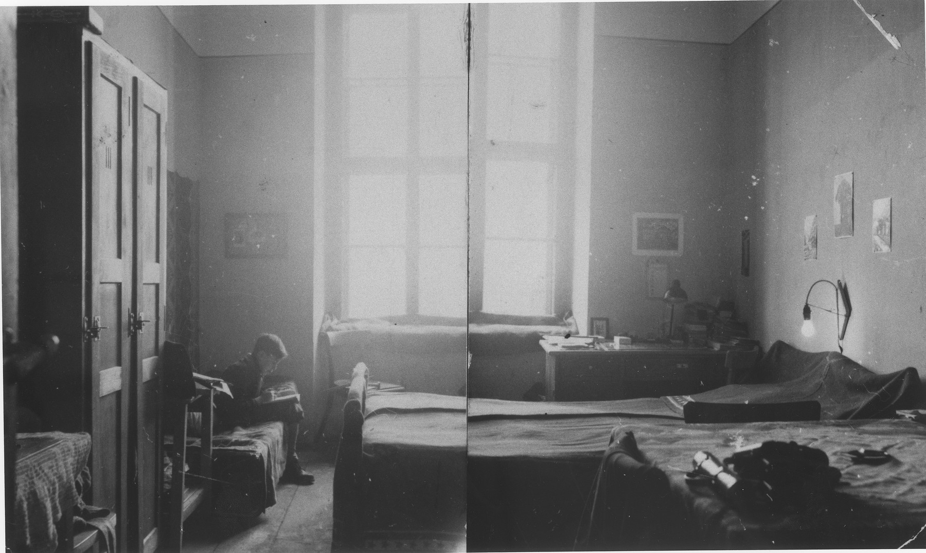 Wolfgang Schaechter studies in his family's apartment in the Enns displaced persons camp.