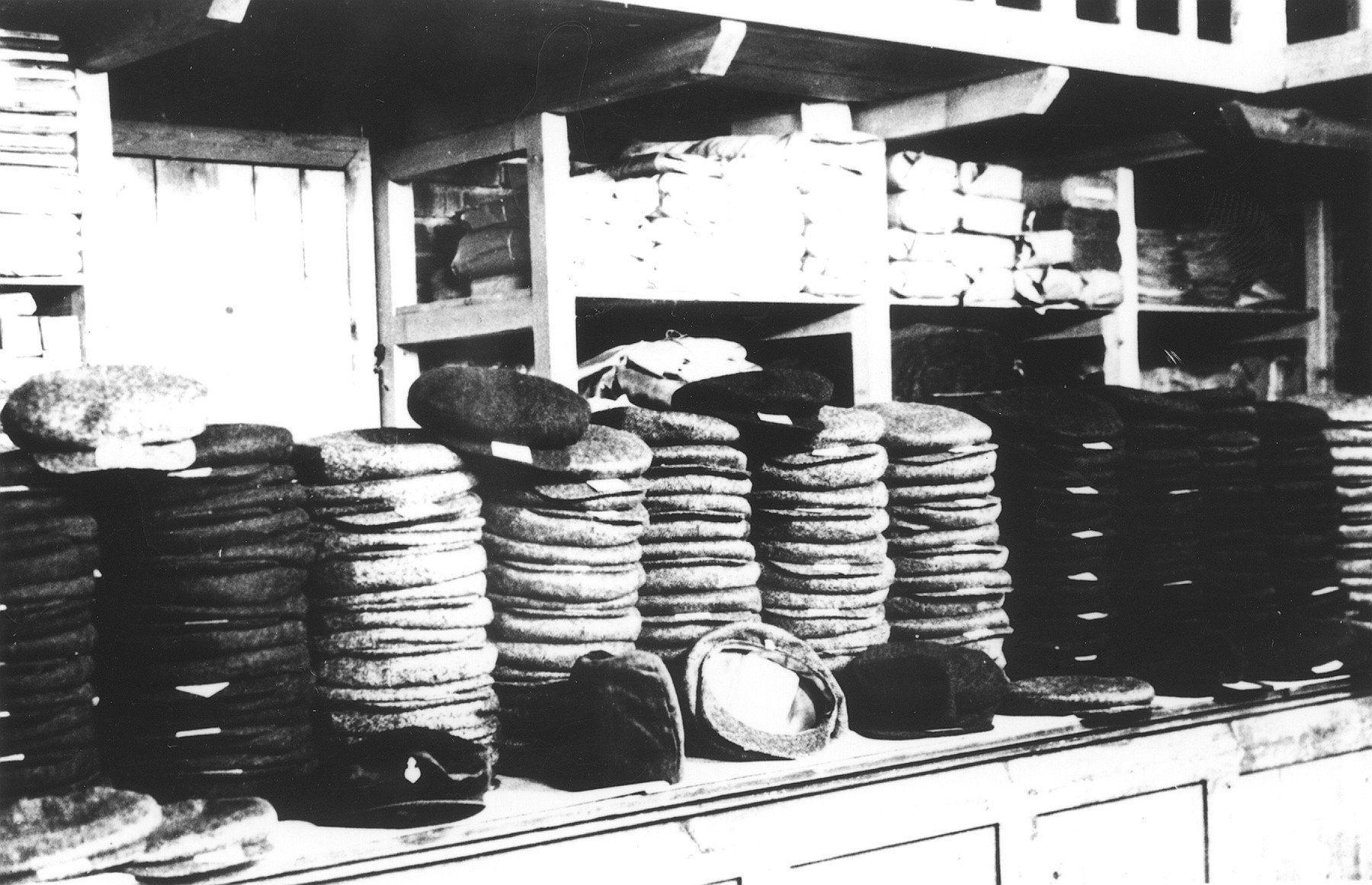 Stack of hats piled in a warehouse in the Novaky labor camp