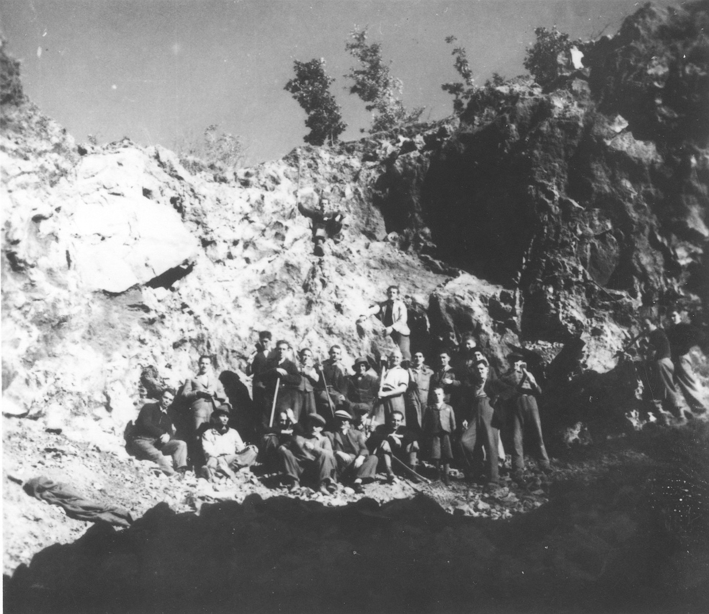 Group portrait of prisoners from the Novaky labor camp at forced labor in a quarry near the camp.