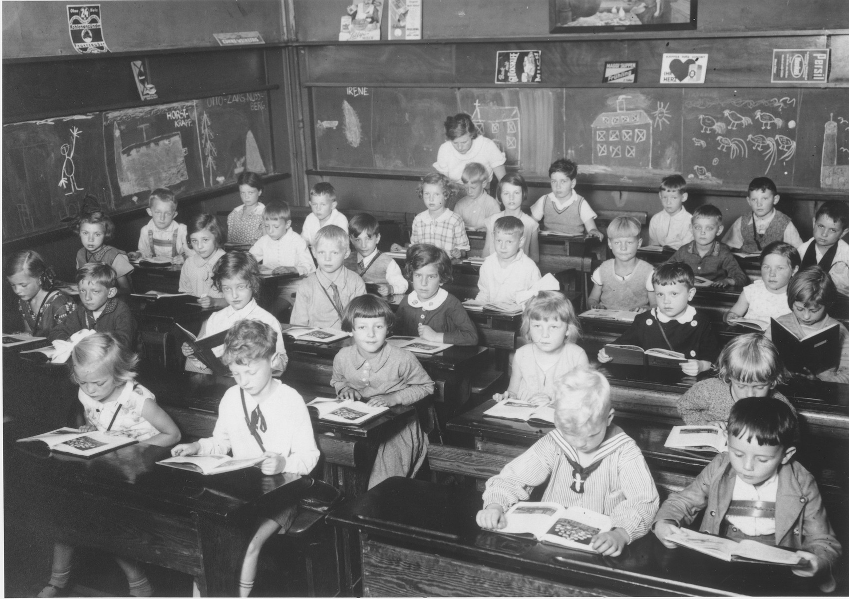 First grade pupils study in a classroom in a public school in Hamburg.  Eva Rosenbaum is seated in the center desk on the right (with the white collar).