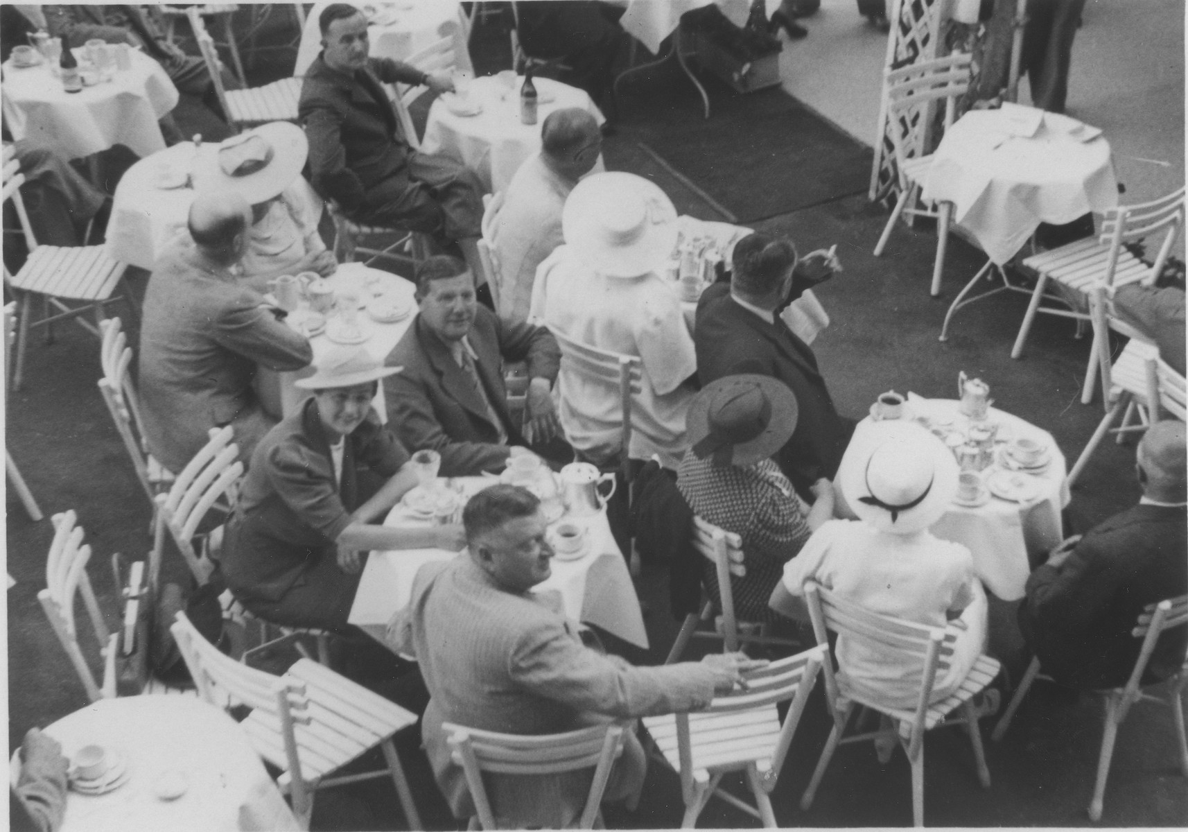 Erna and Boris Segalowitz sit with friends in an outdoor cafe in Karlsbad.