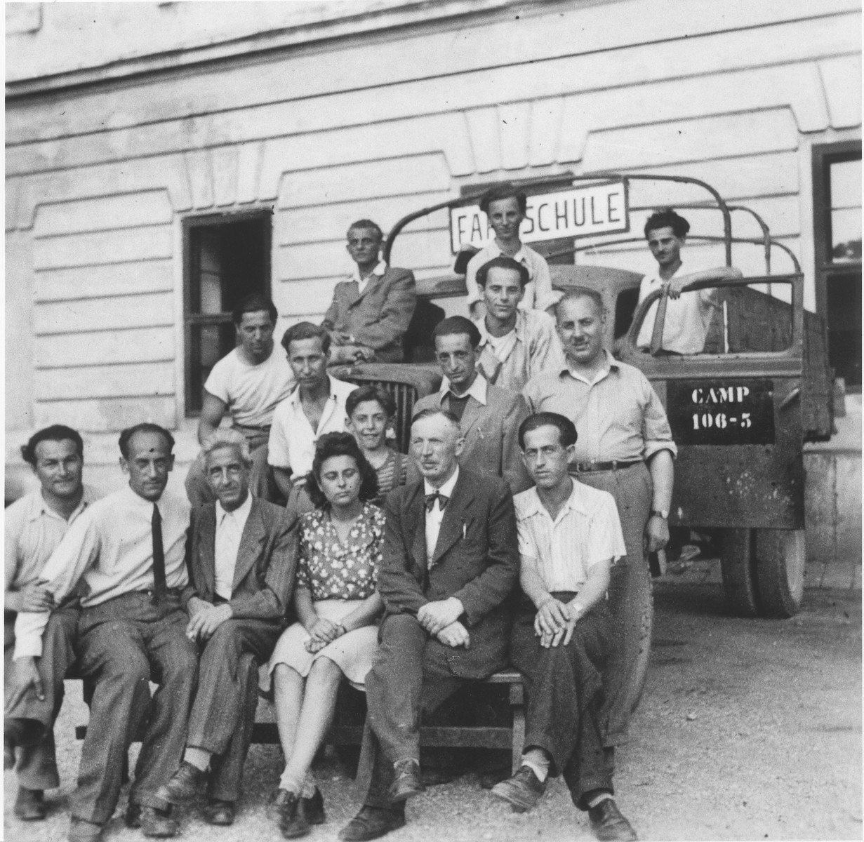 Group portrait of students and teachers of the driver's school in the Enns displaced persons camp.