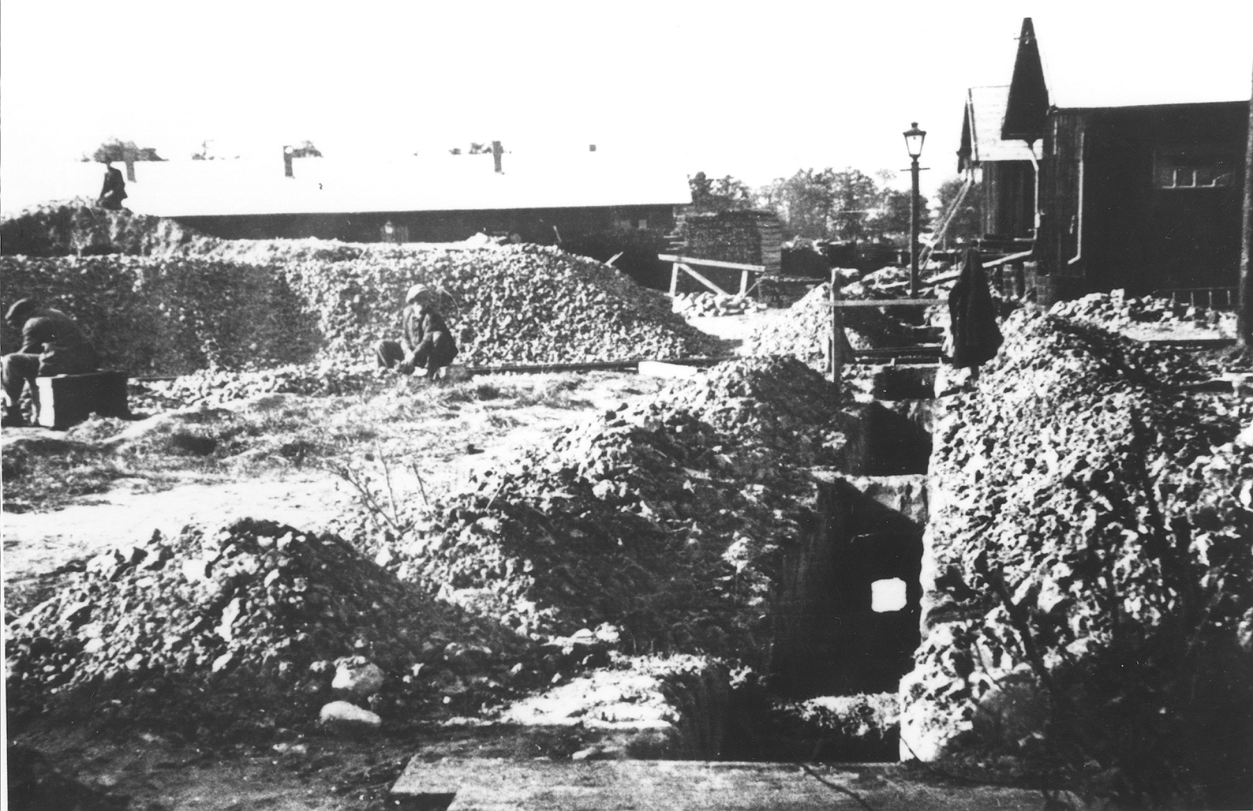 View of latrines that are under construction by prisoners in the Novaky labor camp.