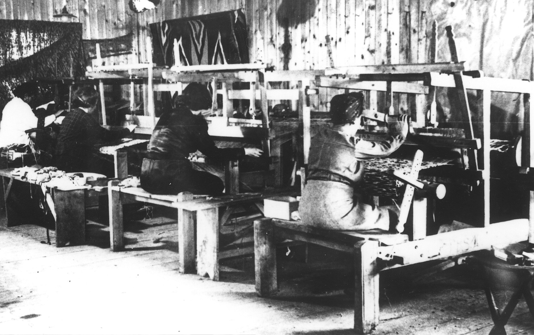 Women prisoners weaving textiles in a workshop in the Novaky labor camp.