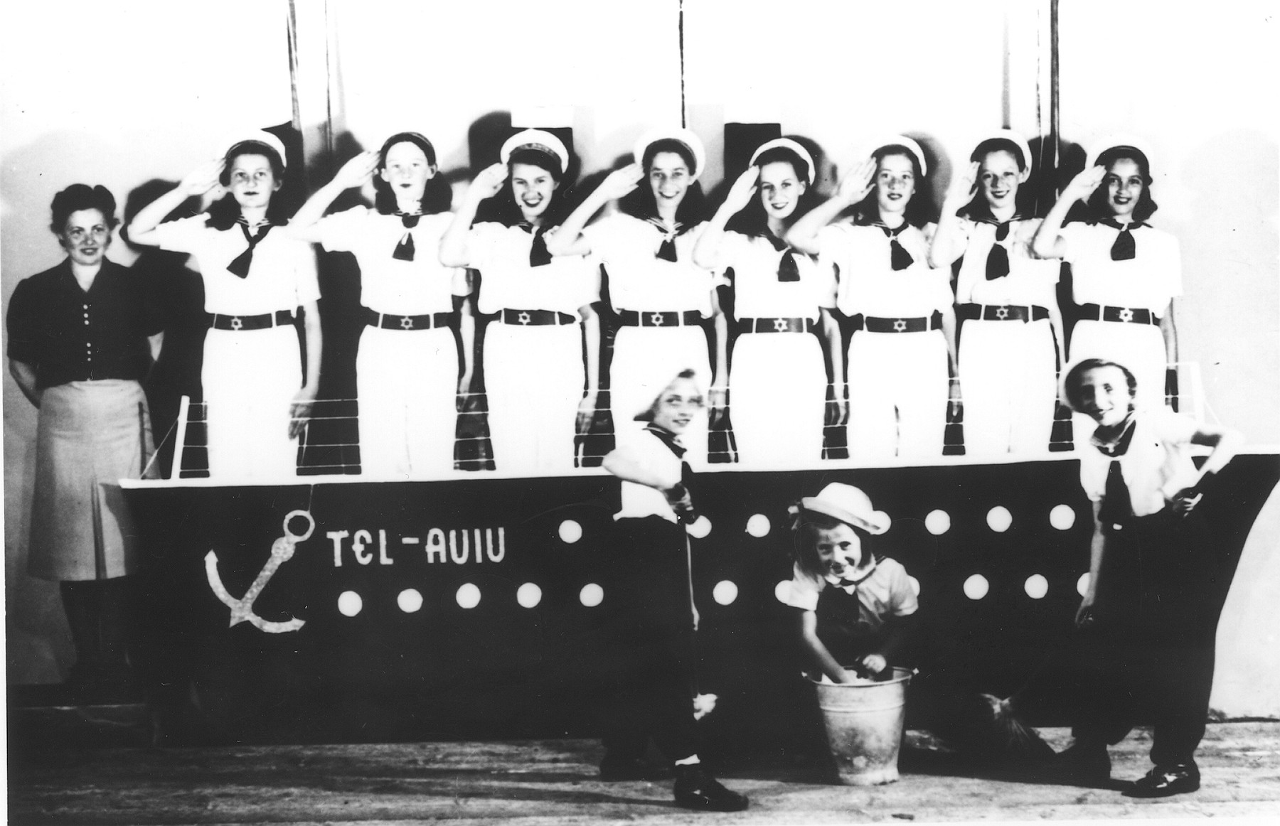 Young women dressed as sailors perform a musical in the Novaky labor camp
