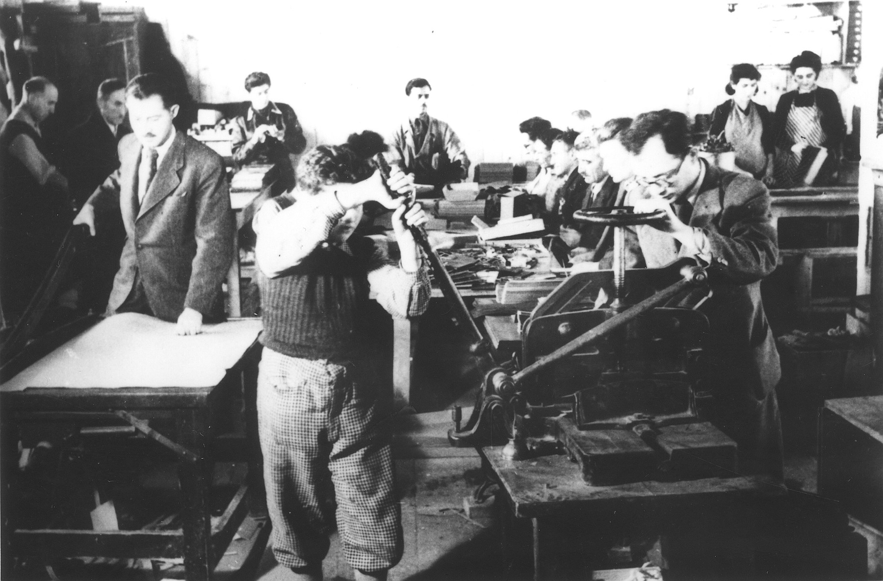 Prisoners making paper products in a factory at the Novaky labor camp.