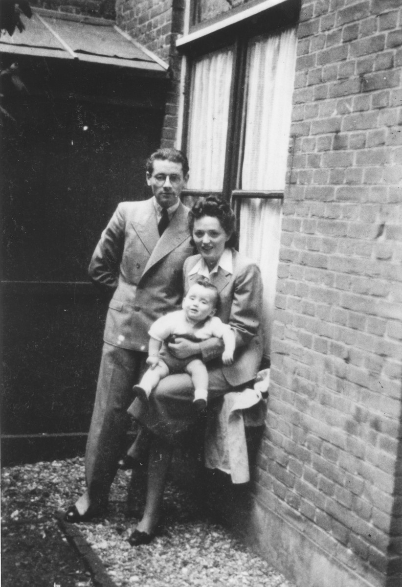 Leo and Emmy Krell pose with their son Robert outside their home in The Hague.