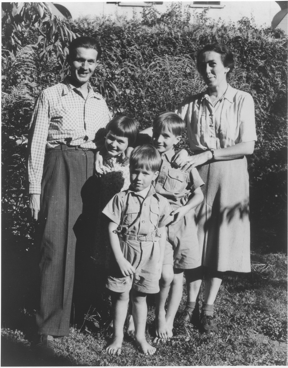 Walter and Emma Gianinni pose with three children in the Faverges children's home.  The Gianinnis later assisted Berthe Silber in escaping to Switzerland.