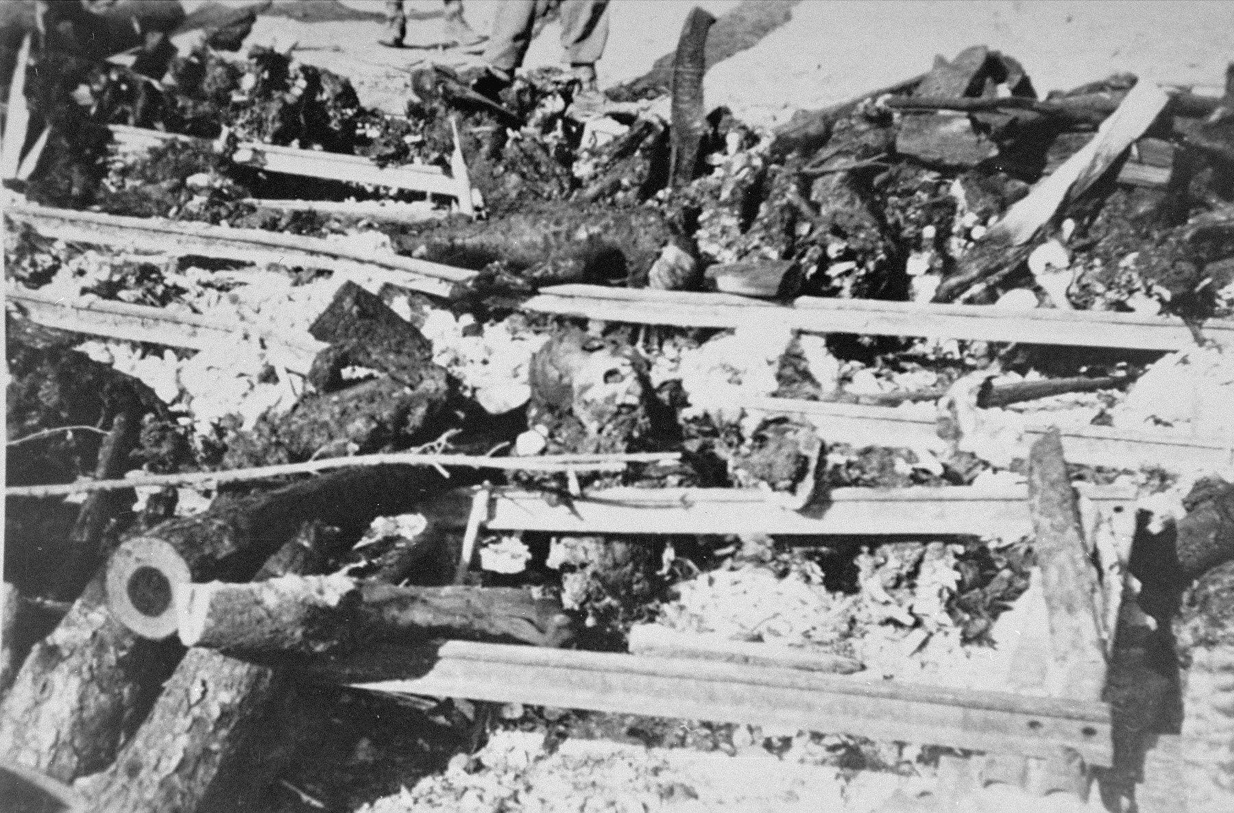 The charred remains of prisoners burned by camp personnel prior to the evacuation of Ohrdruf.