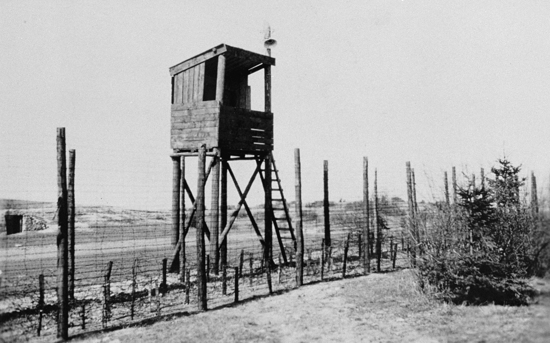 A watch tower and section of the barbed wire fence that surrounded Ohrdruf.