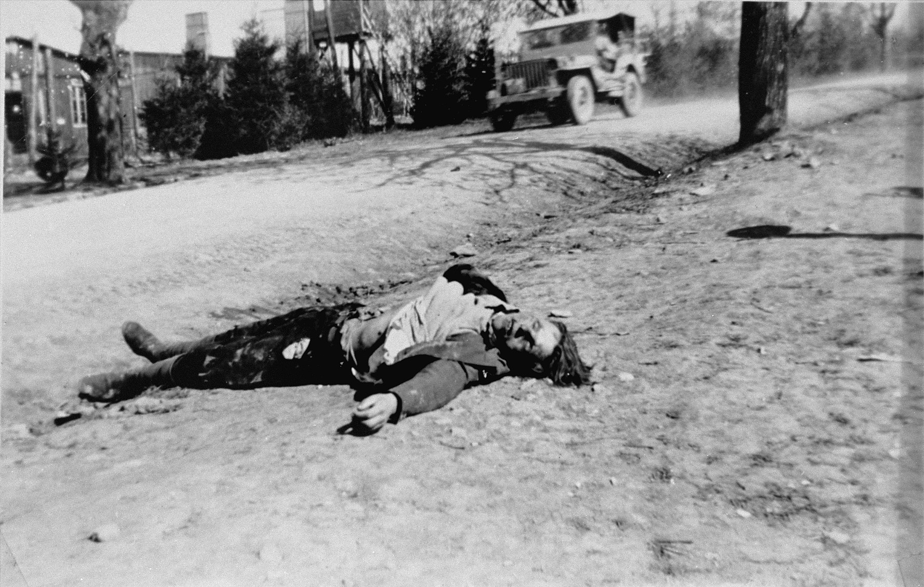 The corpse of an SS guard who was killed by Soviet prisoners after the arrival of American forces at Ohrdruf.